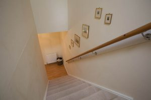 Staircase between living room and bedrooms