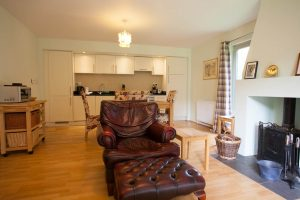 Open plan living, dining and kitchen areas