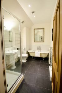The Bathroom with separate shower and deep bath tub