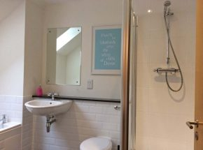 En-suite bathroom with separate shower and bath.