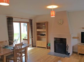Club Cottage - log burner.