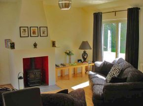 Riverside Cottage - spacious and warm living room.