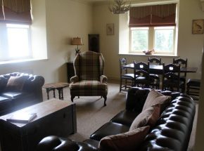 Spacious lounge, views of Loch Ness