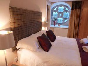 The Ross, master bedroom original stone window