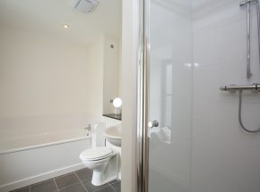 En suite has separate shower and bath