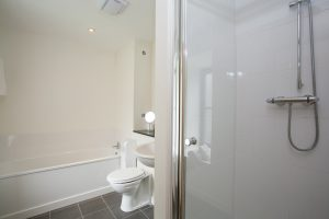 En suite has separate shower and bath