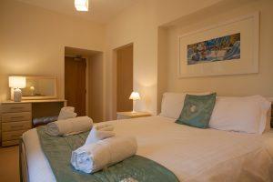 Caledon master bedroom with en suite bathroom