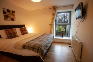 The bedroom is bright and airy with view of the Abbey grounds