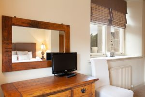 Master bedroom with views over the Cloisters and South Loch Ness