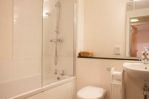 Bathroom has shower over bath
