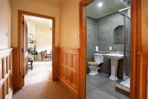 Fraser Apartment hallway and family bathroom