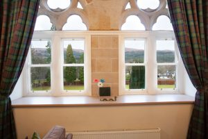Original sash and case windows leading to views of the Abbey grounds and the Great Glen