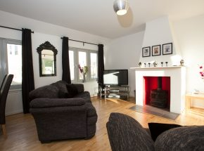 Bright and spacious with log burner