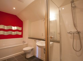 En suite bathroom with separate shower and bath