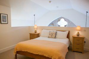 Mezzanine bedroom has view into the Great Glen