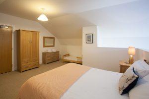 Mezzanine bedroom has toddler bed