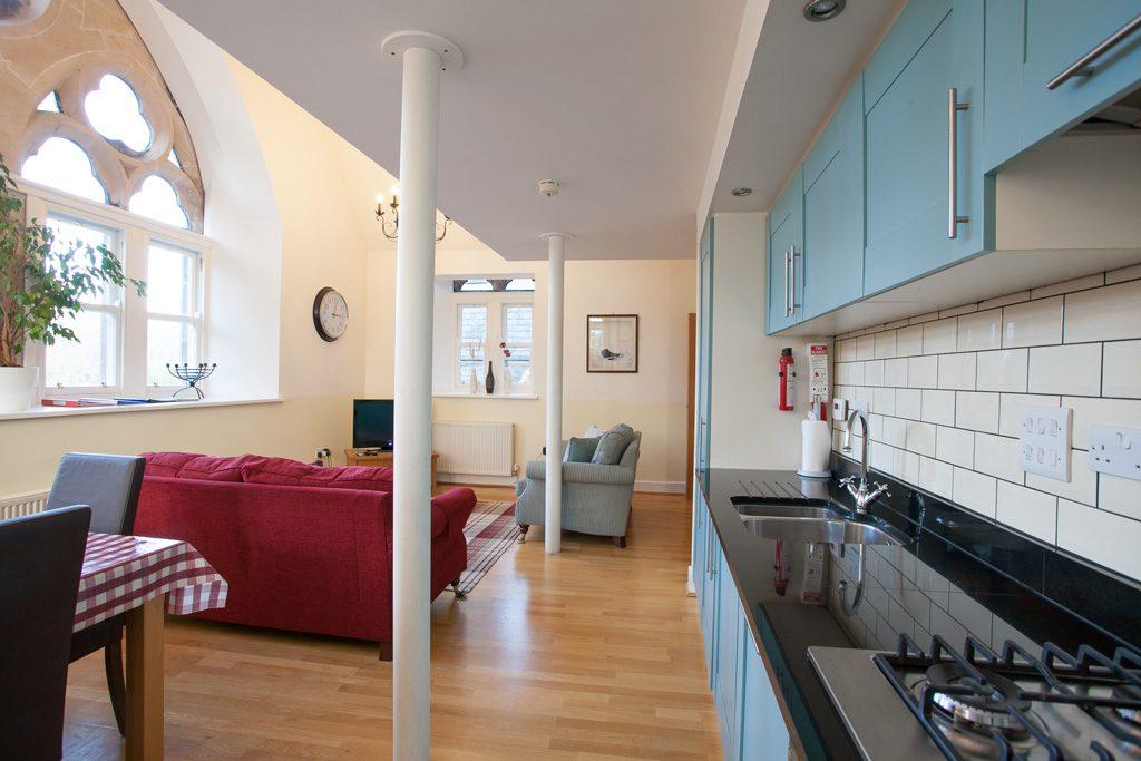 Original pillars support the mezzanine bedroom