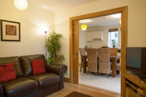 Sliding doors offer privacy from the kitchen area