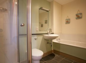 En suite bathroom with seperate shower and bath