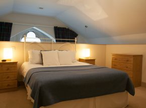 Mezzanine bedroom with a view to the hills of the Great Glen
