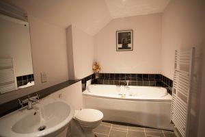 Second bedroom has jacuzzi bath