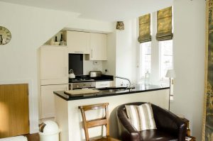 The kitchen area with black granite worktop