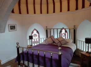 Scriptorium Garden bedroom with original stained glass windows