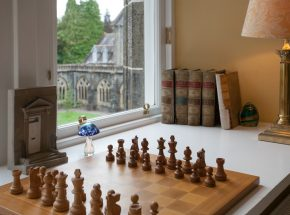 Enjoy a game of chess with views to the Cloister Garden
