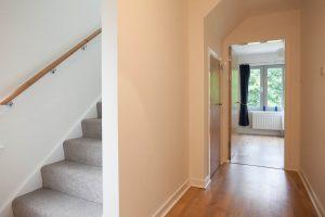 Hallway leading to twin bedroom and upper bedroom