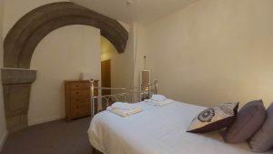 Master bedroom - original chapel sandstone features