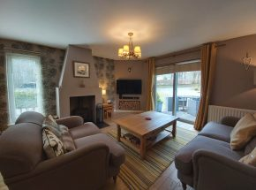 Strathglass Cottage warm, cosy and inviting living room