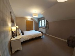 Strathglass Cottage master bedroom is very spacious