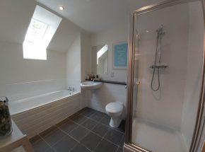 Strathglass en suite bathroom has seperate shower and bath